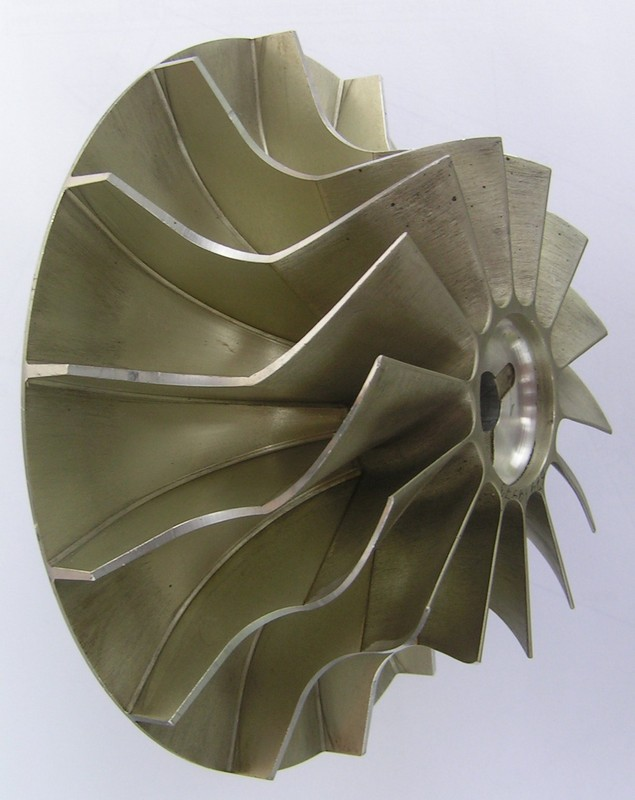 an impeller of radial compressor which is fixed by andhesive from one a duralumin cast and precision duralumin forging.